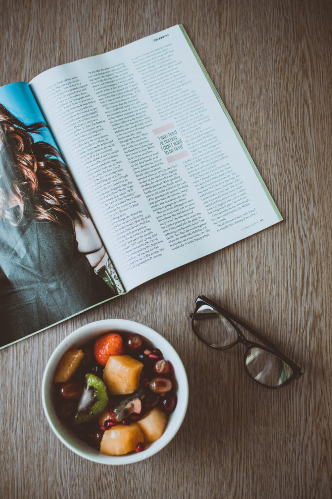 Canva - Eyeglasses Beside Bowl of Food and Magazine on Table