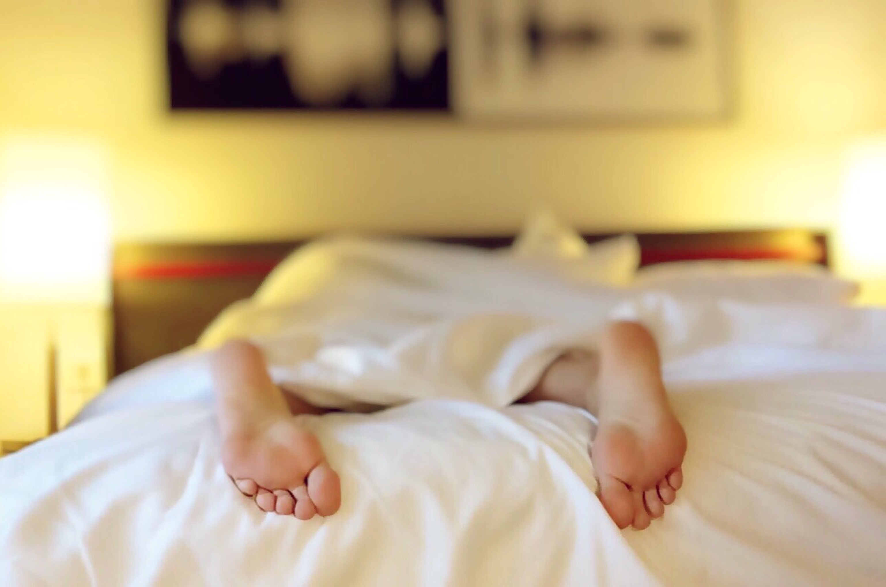 Canva - Person Lying on Bed Covering White Blanket
